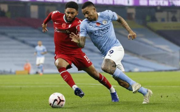Joe Gomed battles with Gabriel Jesus for the ball