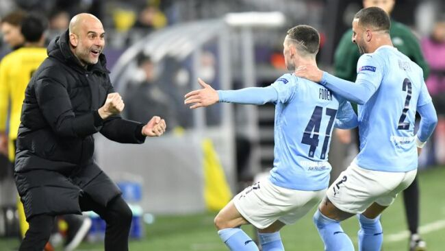 Pep Guardiola celebrating Phil Foden's goal