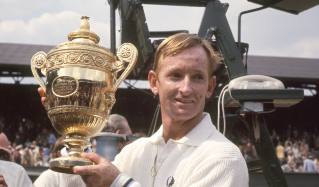 Rod Laver posing with his Wimbledon title in 1969.
