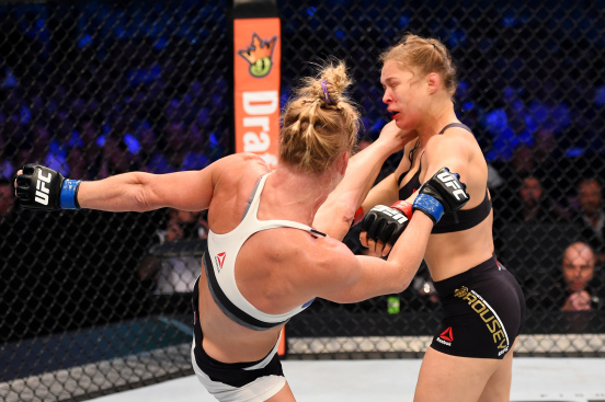 Holly Holm kicking Rousey