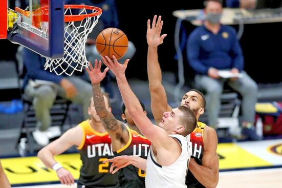 Nikola Jokic from the Nuggets, goes to the basket against the Utah Jazz