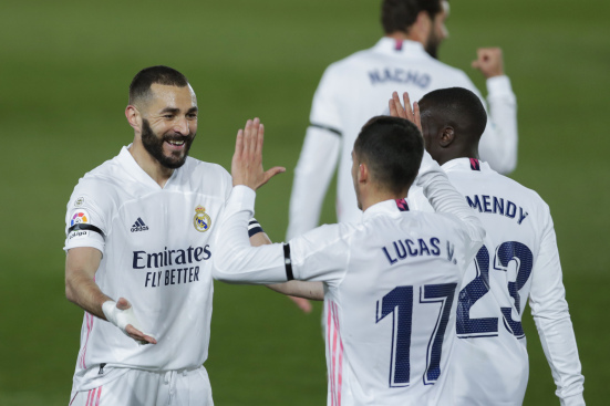 Karim Benzema celebrates with Lucas Vasquez
