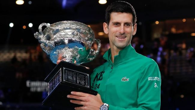 Djokovic lifting the 2020 Australian Open Trophy