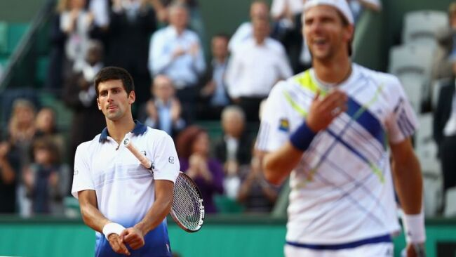 A dejected Djokovic after his stunning loss to Jurgen Melzer in the French Open 2010 Quarterfinals