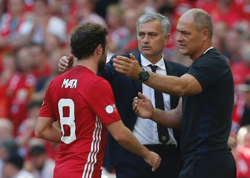 Juan Mata greeted by Jose Mourinho after being subbed off
