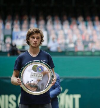 Rublev poses with his silverware after finishing as the runner-up in the ATP-500 Halle Open