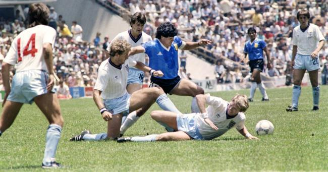 Diego Maradona dribbles past three English defenders during the 1986 World Cup quarterfinal match