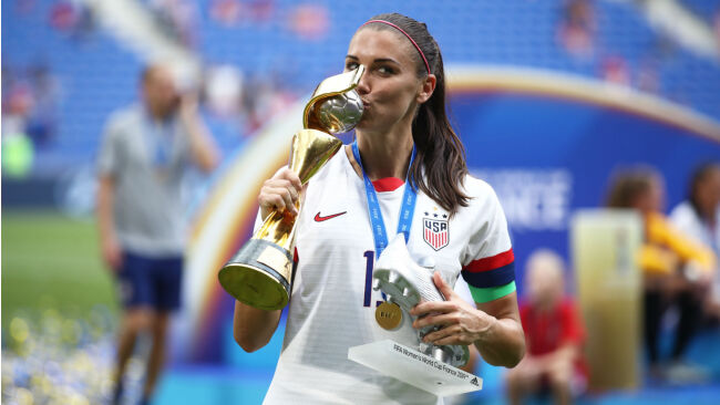 Alex Morgan with the silver boot trophy