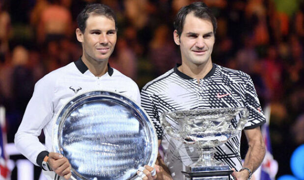 Federer and Nadal pose with their silverware after the finals of the Australian Open 2017