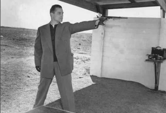 Karoly Takacs practicing with his left hand